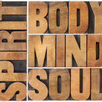 body, mind, soul and spirit word abstract - a collage of isolated text in vintage wood letterpress printing blocks